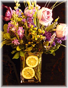 Flowers In a Vase With Lemons