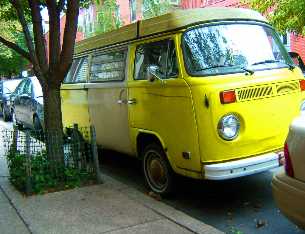 Antique VW Vanagon Wagon Parked Next To Tree With Base Plantings