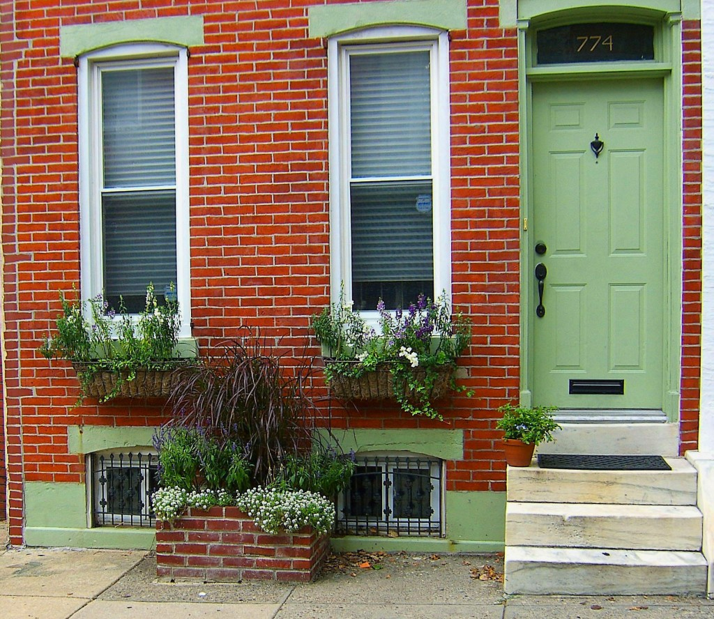 Brick Sidewalk Planter & Two Window Boxes In Front Of Row Home