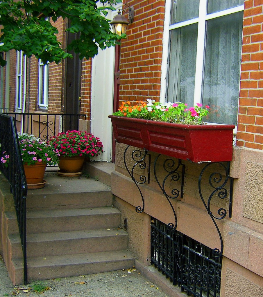 Decorated City Row Home With Newer Flowered Window Box & Step Planters