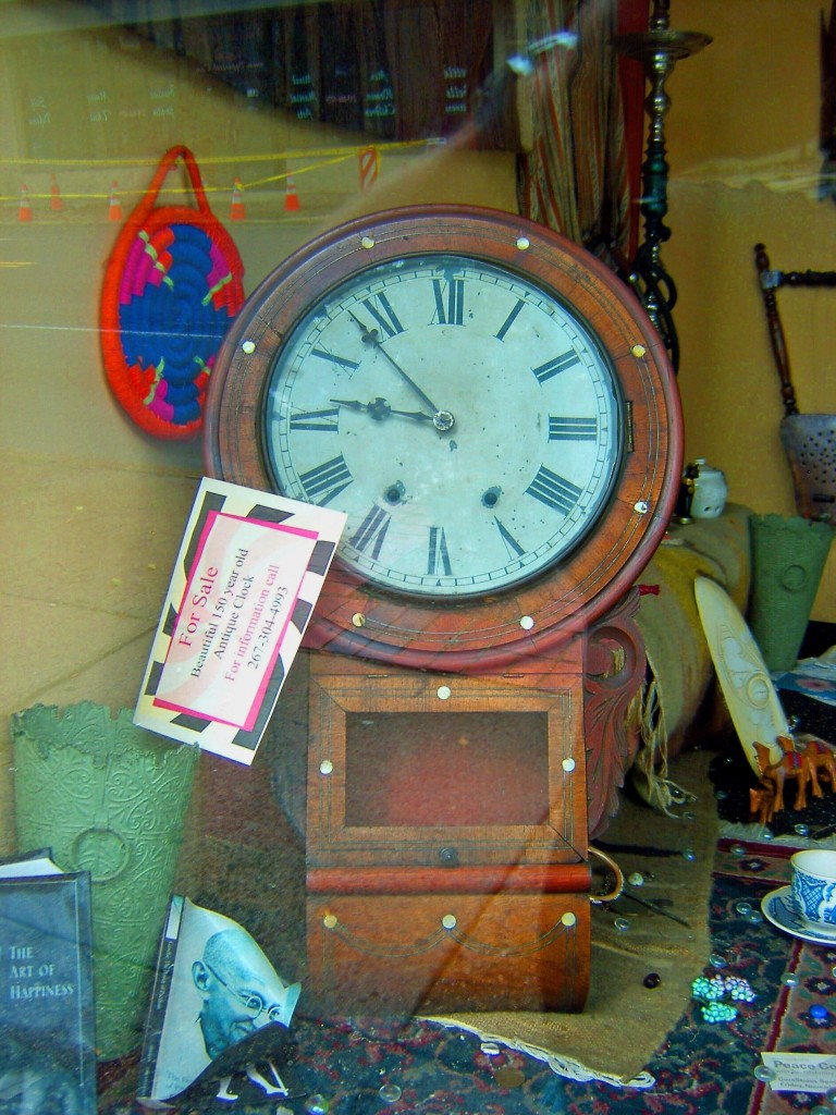 150 YEAR OLD ANTIQUE CLOCK DISPLAYED IN HOOKAH LOUNGE WINDOW