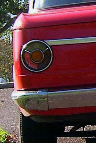 REAR TAIL LIGHT OF ANTIQUE RED 1969 BMW 2002 SEDAN
