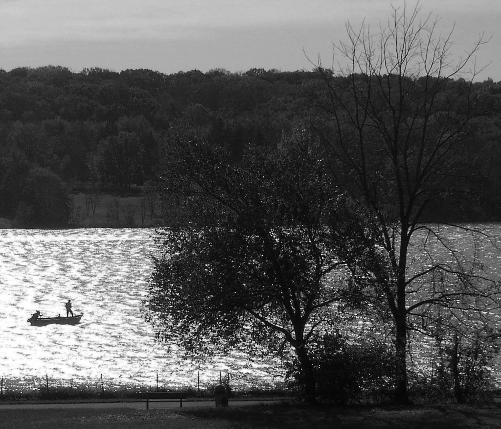 BLACK & WHITE OF SOLO MOTORBOAT FISHERMAN ON LAKE GALENA