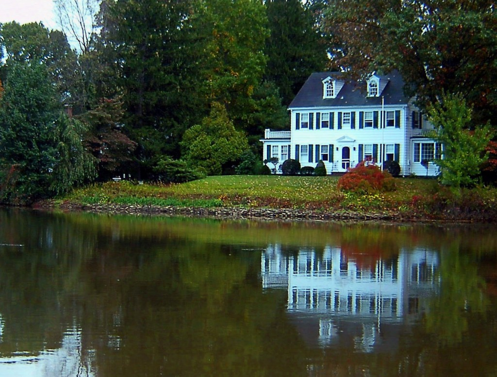 SHORE LINE ESTATE REFLECTING ON LAKE BRAINERD