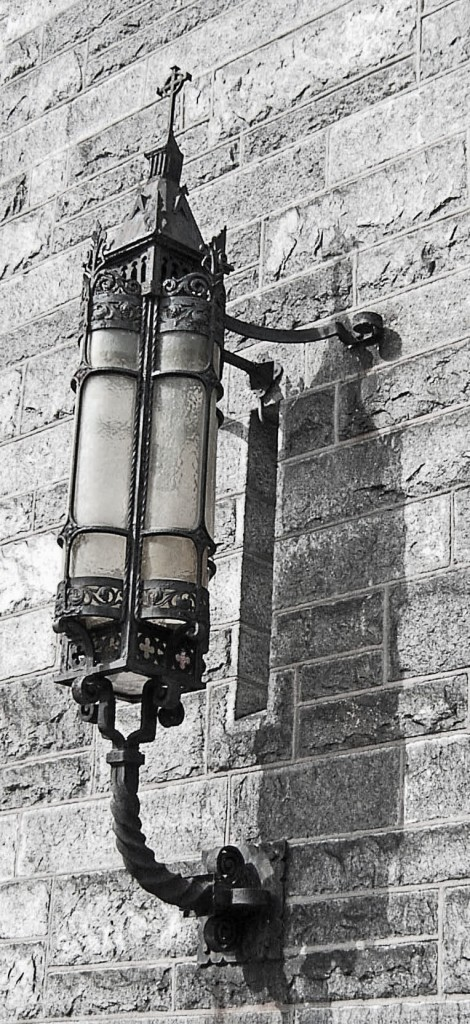 BLACK & WHITE OF ANTIQUE LAMP ON PHILADELPHIA CHURCH
