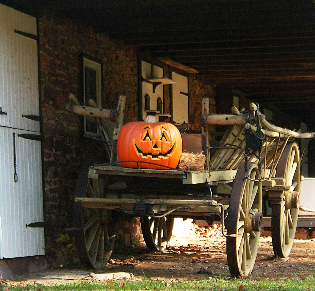 Antique Farm Wagon With Jack O Lantern In Early Fall Morning