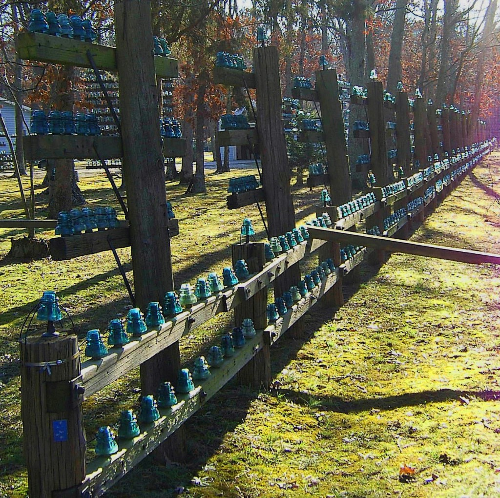 Side Yard Utility Pole Fence With Glass Insulators