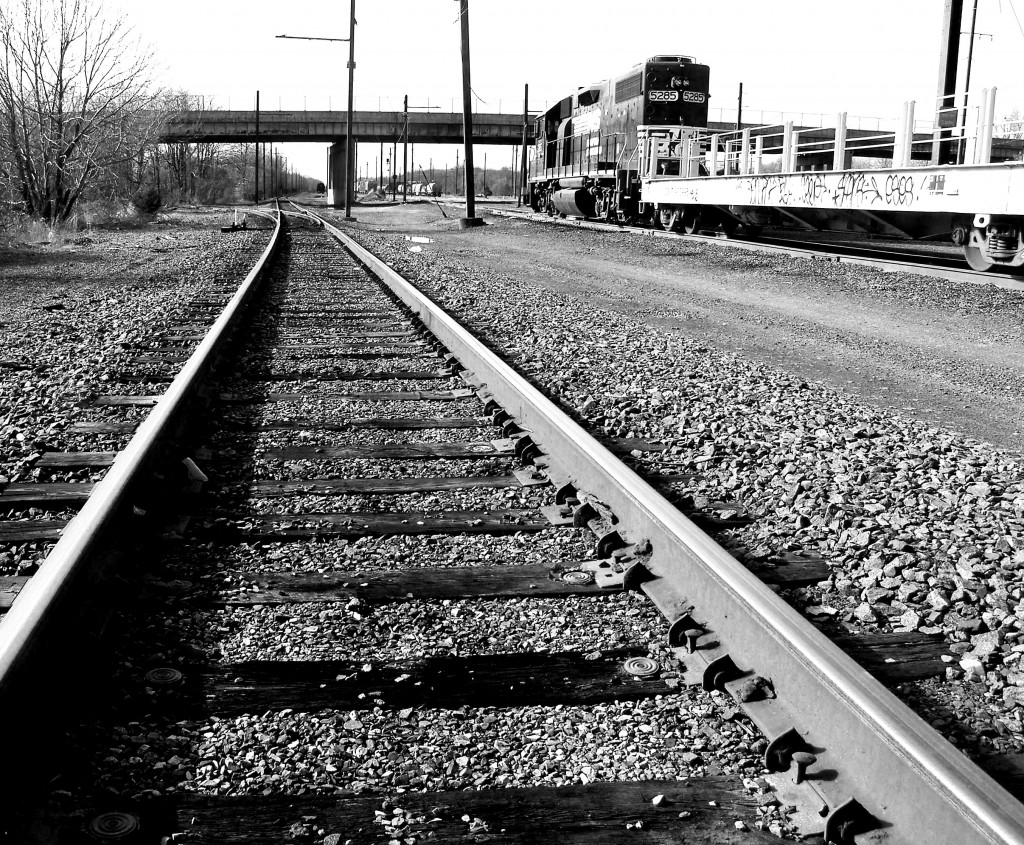 Black & White Train Tracks & Parked Rail Cars