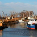 Pilot Boat & Barge Docked In Small Jersey Harbor