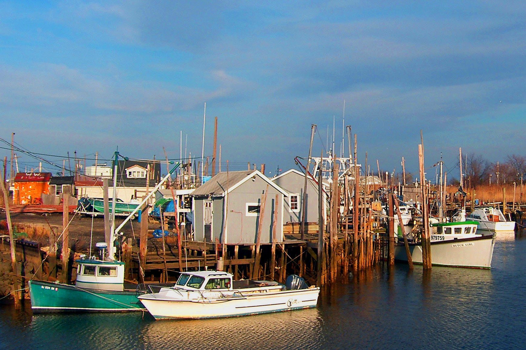 Small commercial fishing boats docked in port monmouth for Port a fishing