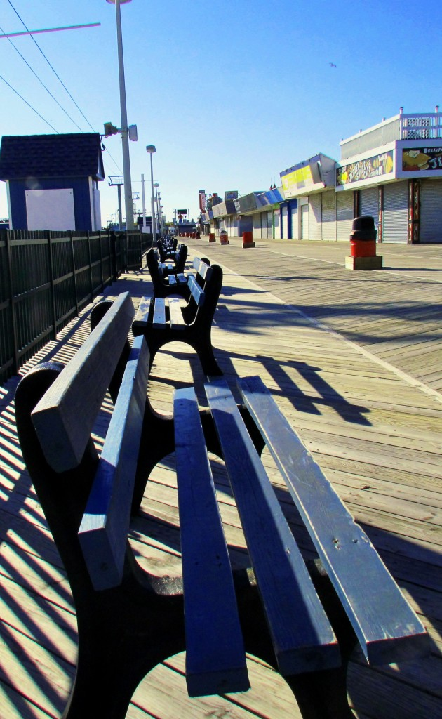 Empty Row Of Benches On Seaside Boardwalk