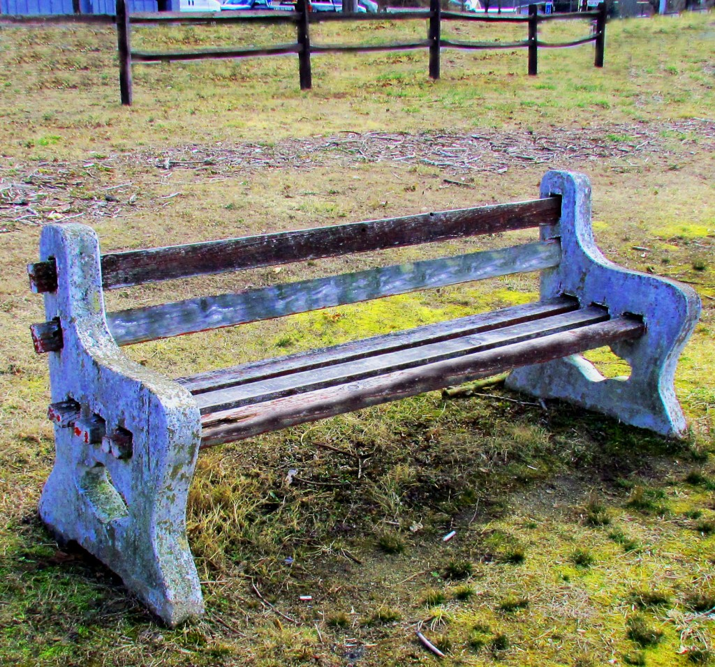 Old Park Bench In Mountain Lake