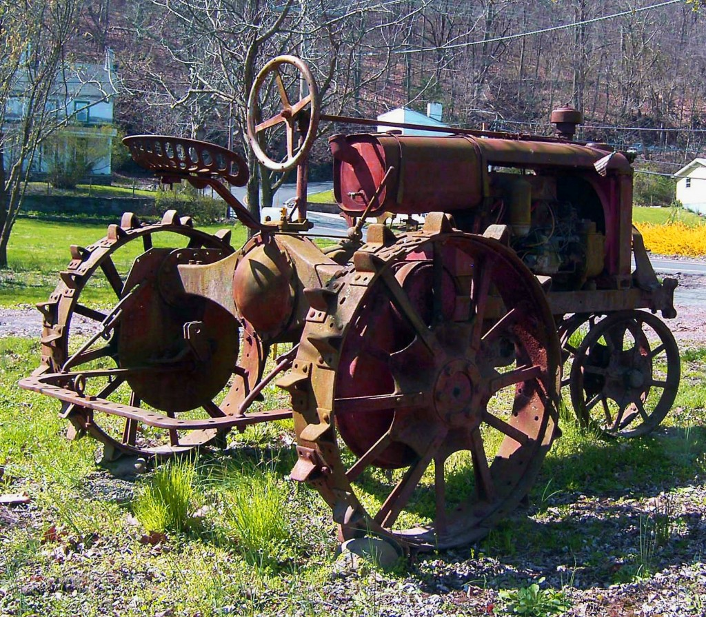 Antique Tractor In Side Yard