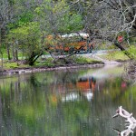 School Bus Reflecting Off Mosconetcong River