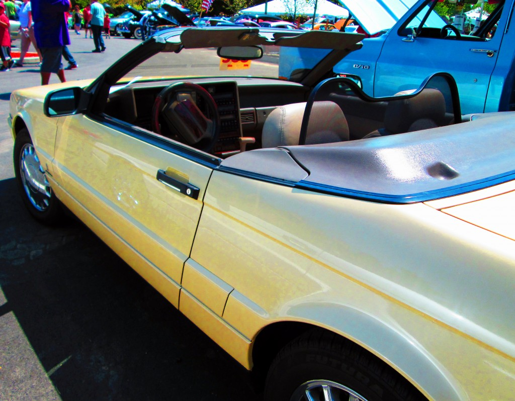 Side View Of Sunshine Yellow Caddilac Allanti Convertible