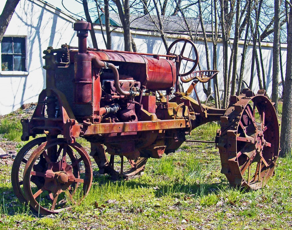 Antique Tractor Parked In Yard