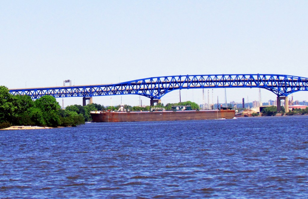 Barge Heading North On The Delaware River By Girard Point Bridge