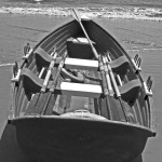Black & White Of Beached Long Boat