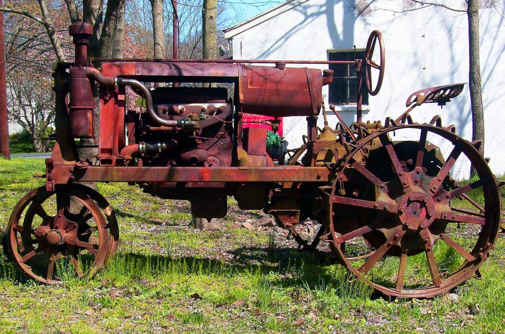 Sideview Of Old Farm Tractor