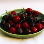 Bing-Cherries-With-Stems-In-Green-Ceramic-Kitchen-Bowl