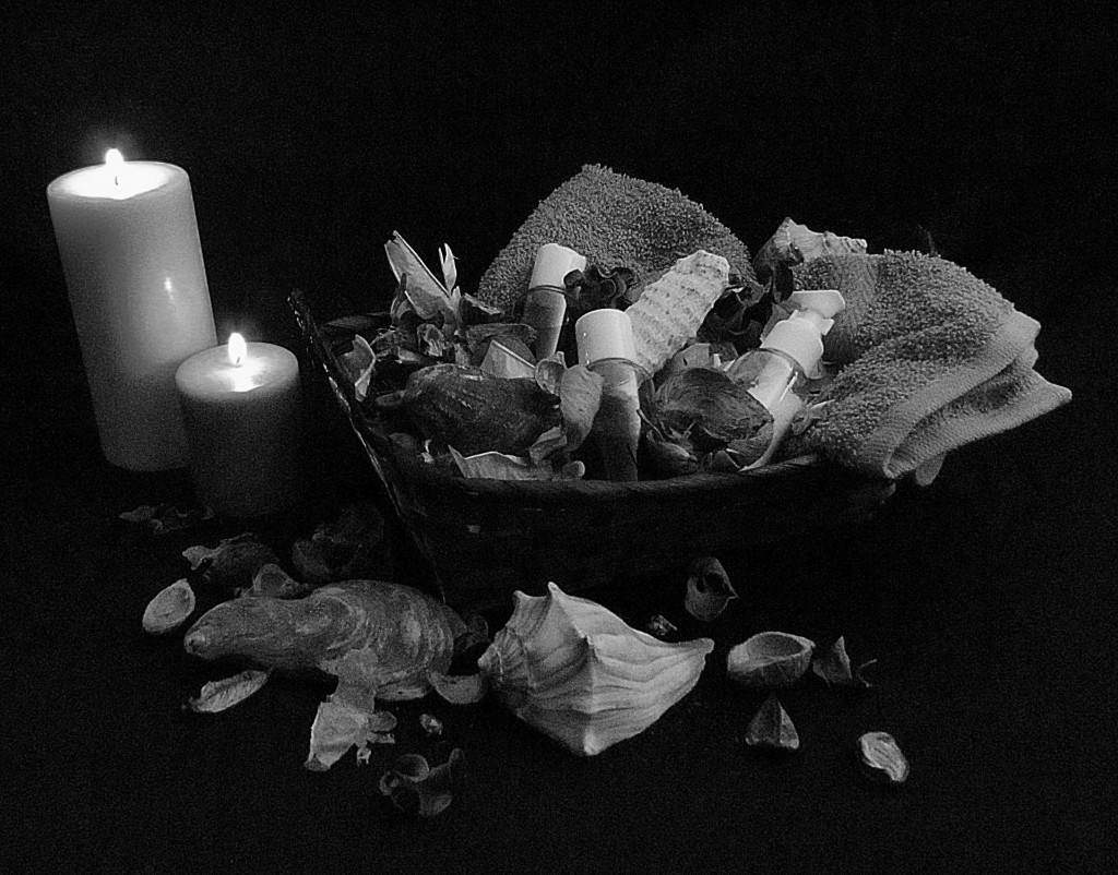Black & White Of Massage Oil Display With Candles