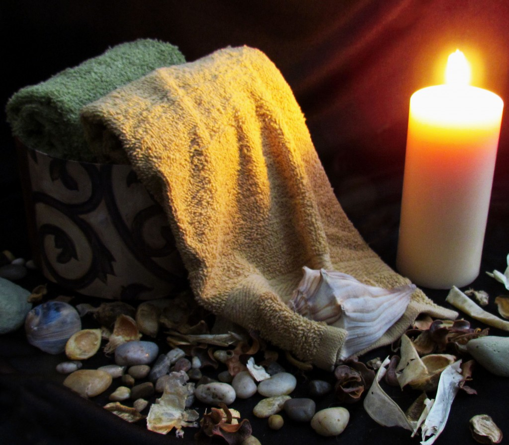 River Stones & Pebbles Displayed With Candle & Hand Towels