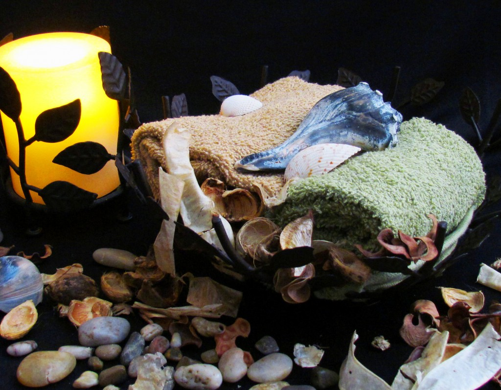 River Stones & Sea Shells Displayed With Flame Less Candle & Massage Towels In Basket