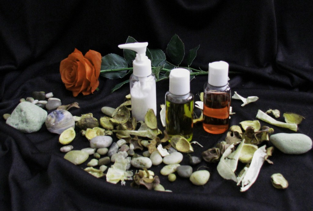 Tangerine Rose Displayd With Massage Therapy Cream & Oils