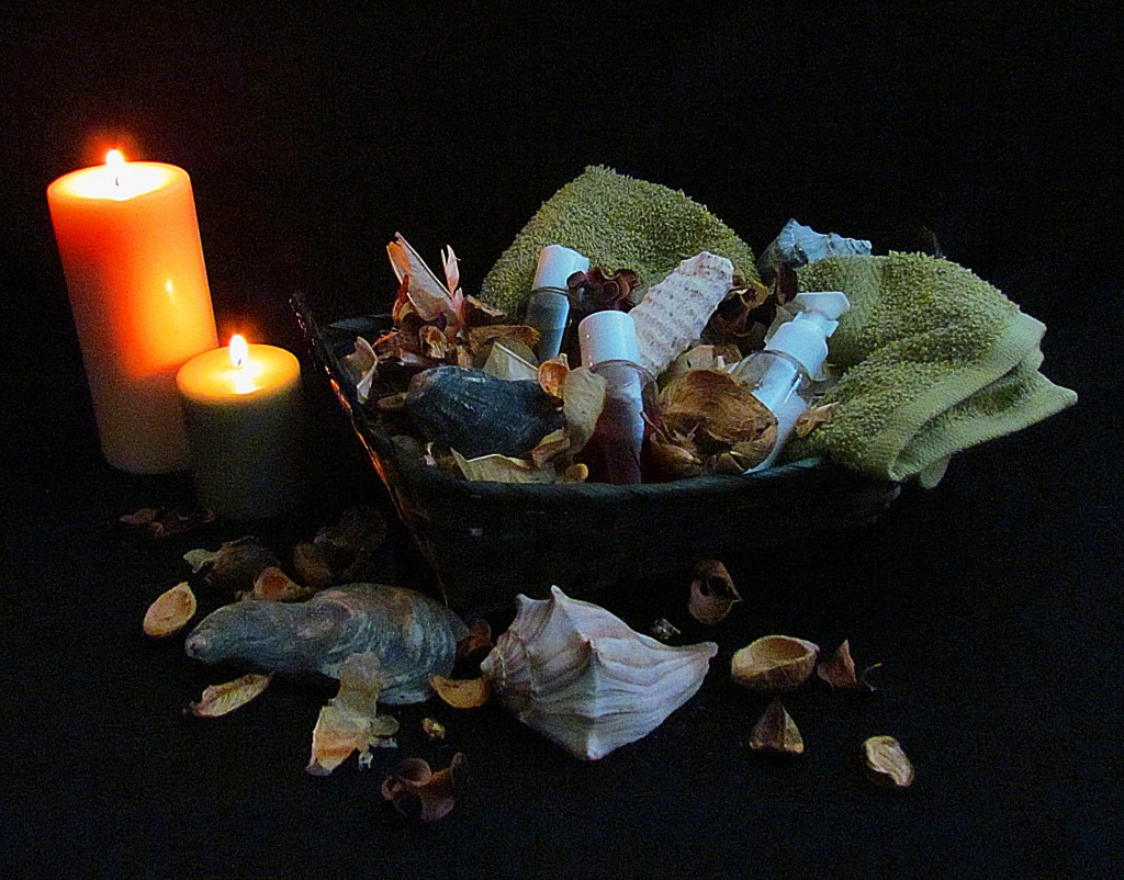 Tranquil Basket Display Of Massage Oils And Towels