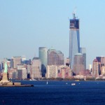 Freedom Towers & Statue Of Liberty Overlooking New York Bay