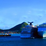 Barge Passing Docked Cruise Ships In The Caribbean