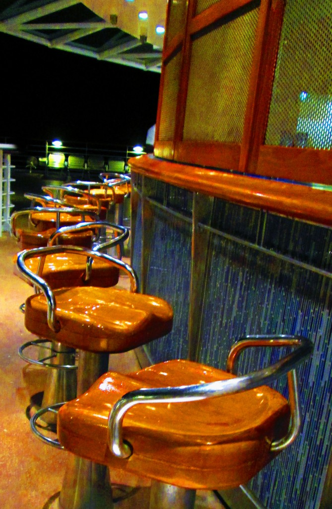 Empty Cruise Ship Bar Stools At Night On The Pool Deck