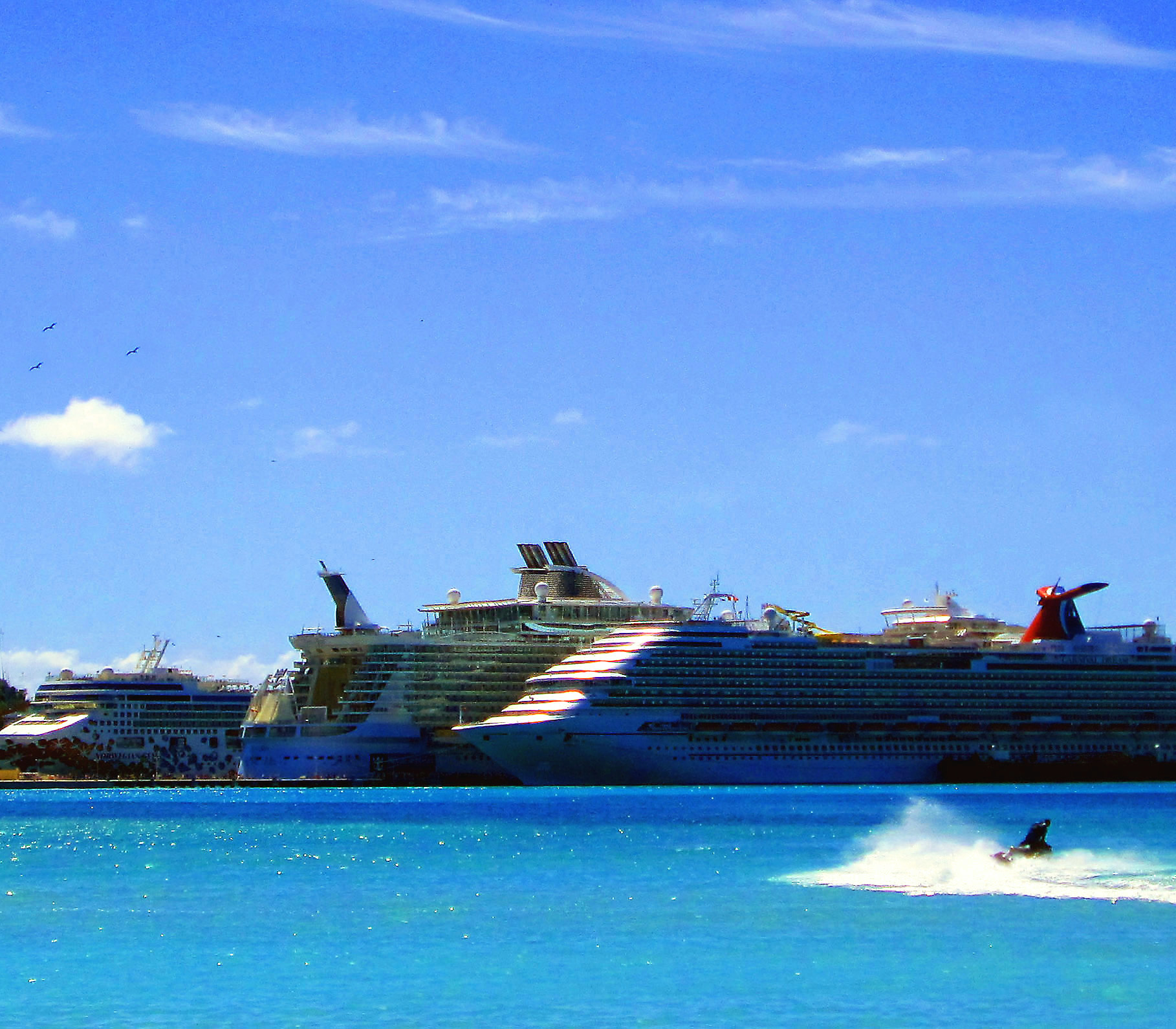 Jet Skiing On Great Bay In St Maarten Near Docked Cruise Ships