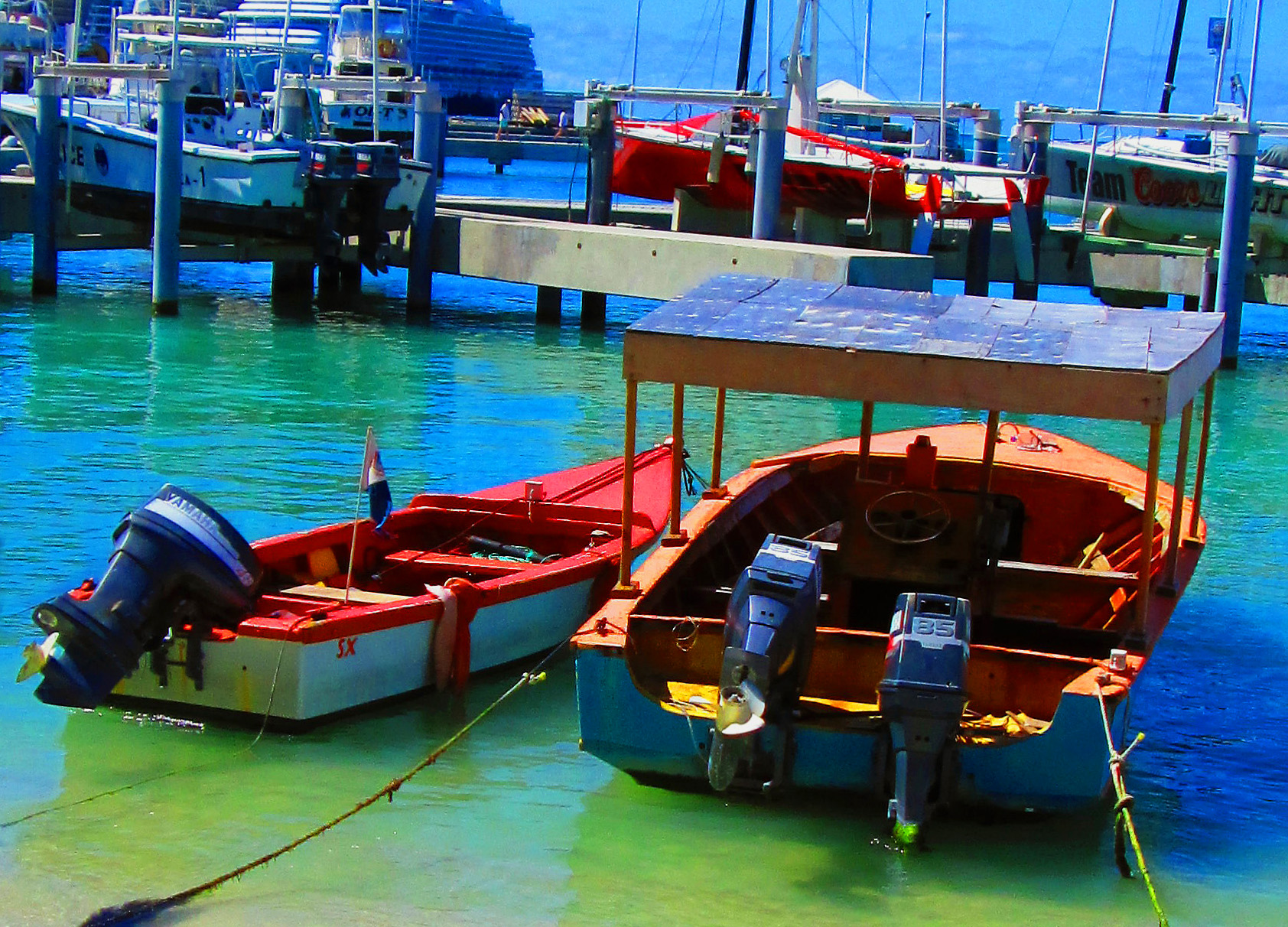 Small-Fishing-&-Platform Boats-Moored-In-St-Maarten