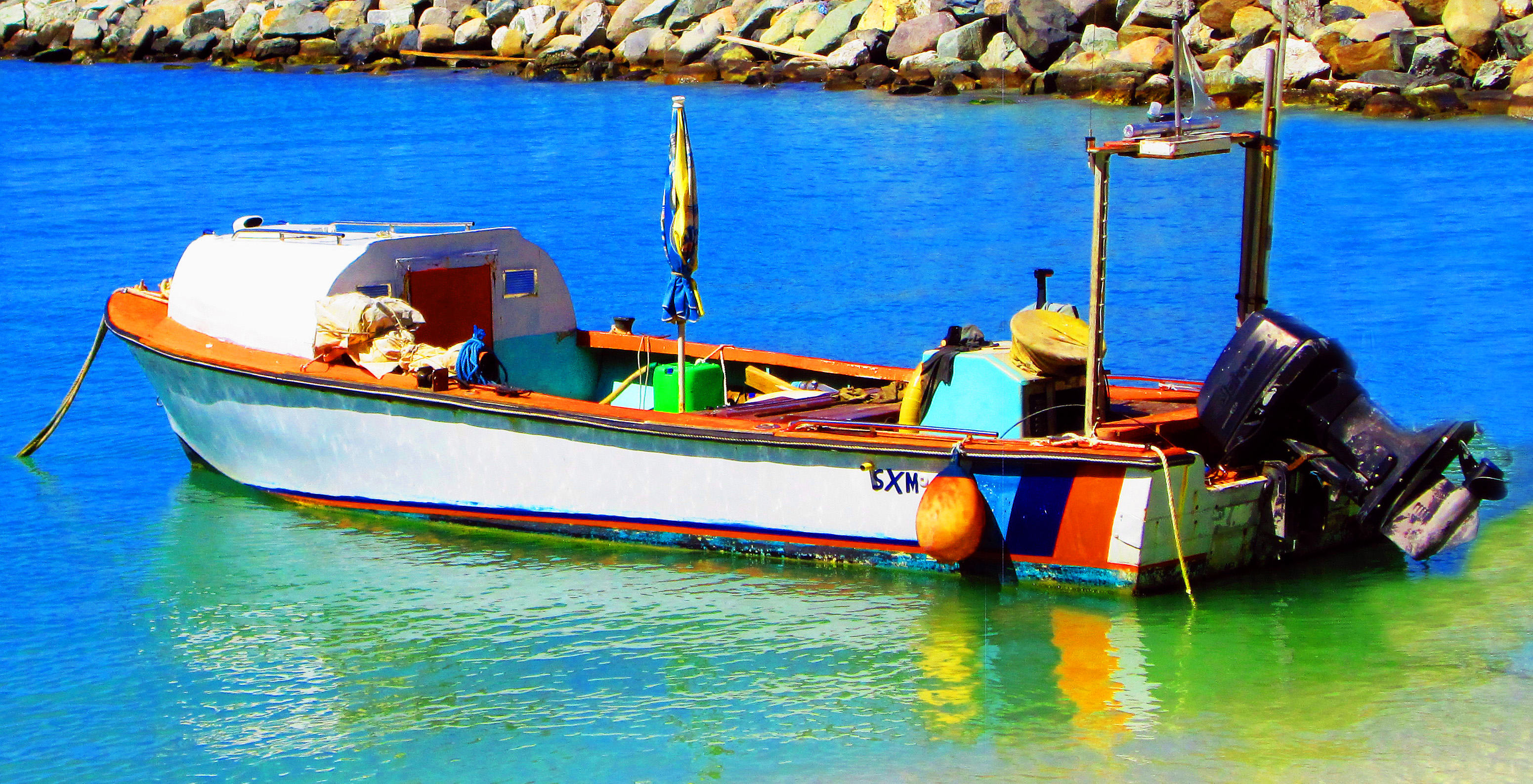 Small Wooden Boat Moored On Front Street Beach