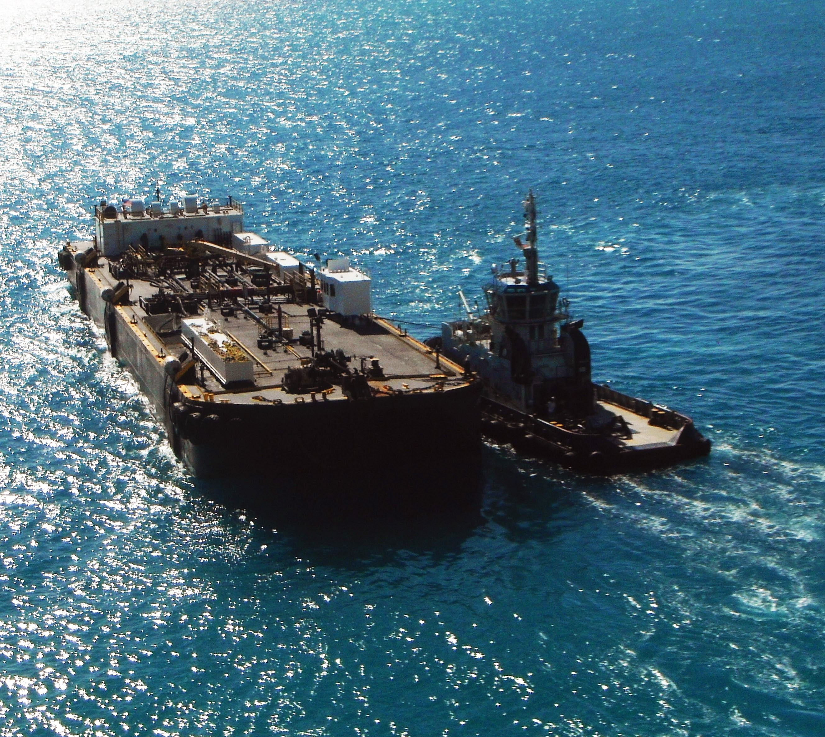 Tug Boat Escorting Fuel Barge To Fuel Depot