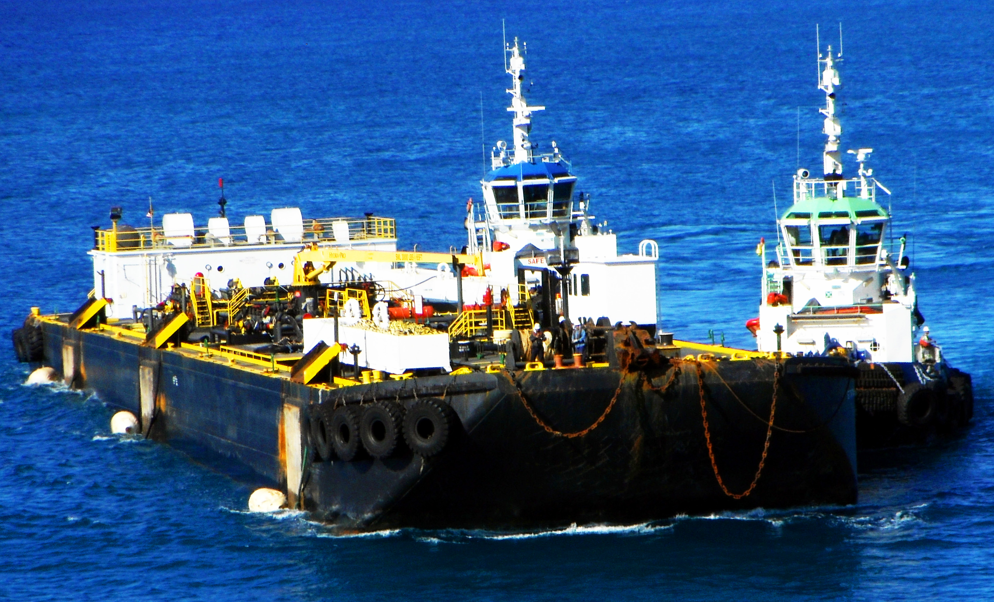 Two Tugs Maneuvering Fuel Barge In St Maarten