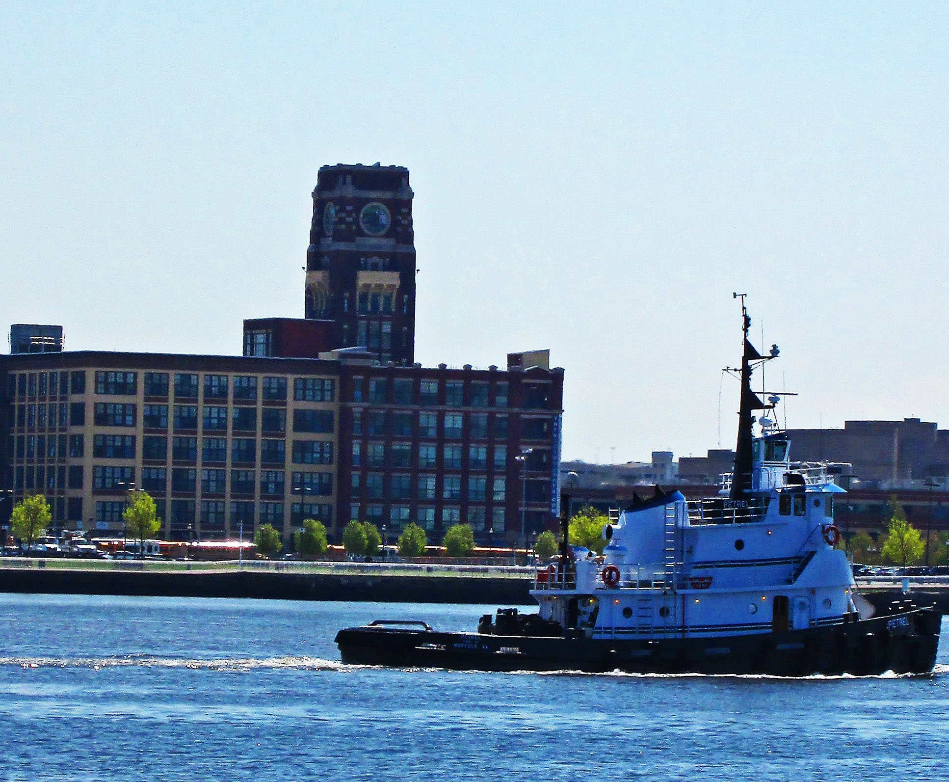 Tug Boat Petrel Passing The Old RCA Building In Camden NJ