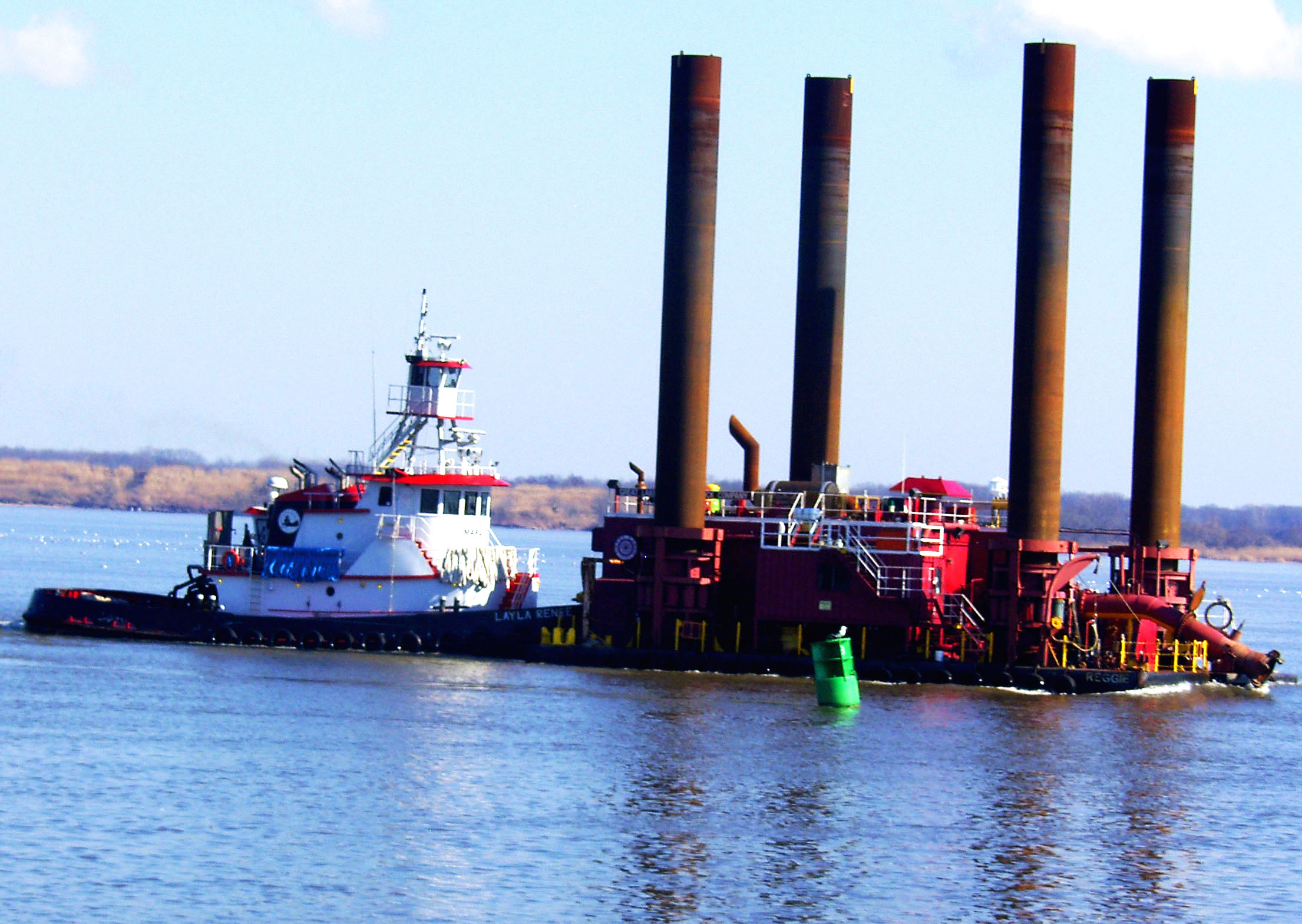 Tug Pushing River Dredger