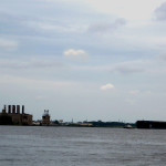 Barge Being Towed Past PECO Coal Tower In Philly