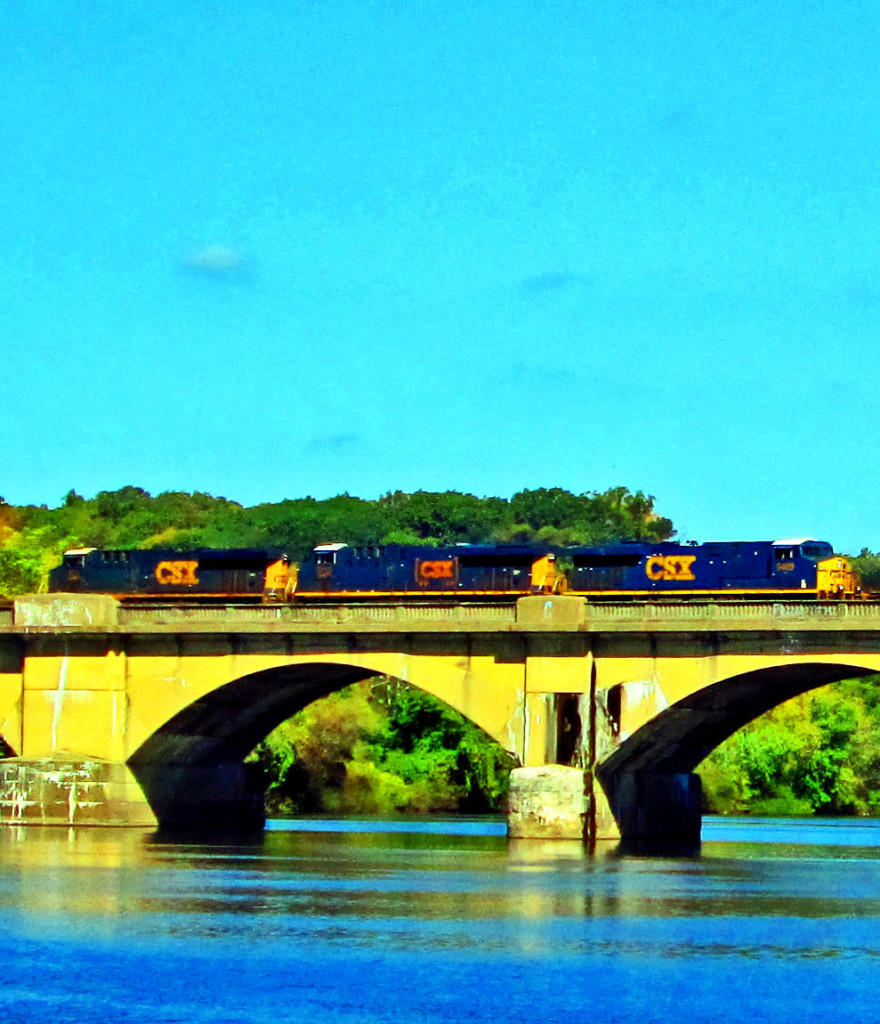 Locomotive Crossing The Schuylkill River On The Columbia Bridge In Philly