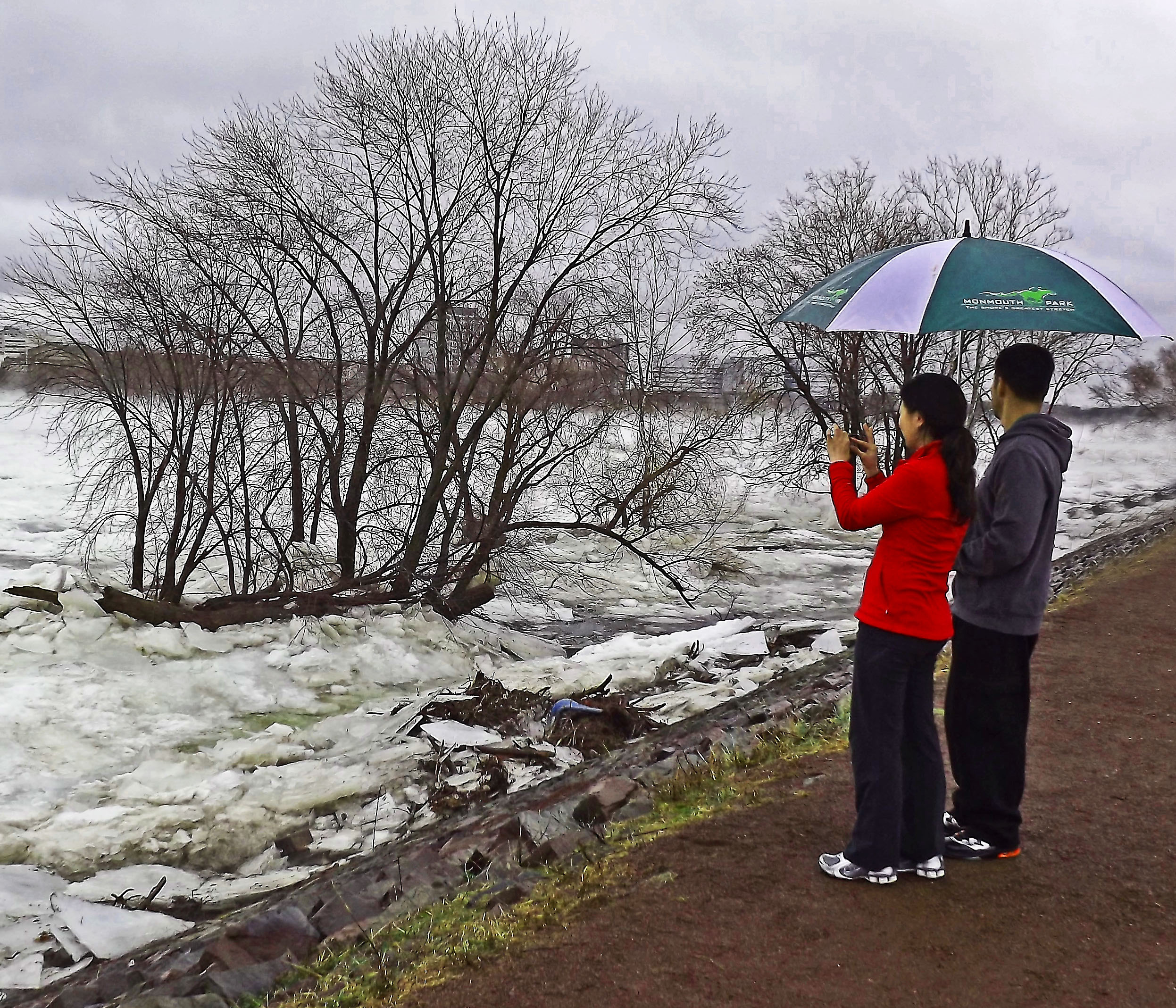 Couple Checking Out The Delaware River Ice Jam On The Morrisville Berm