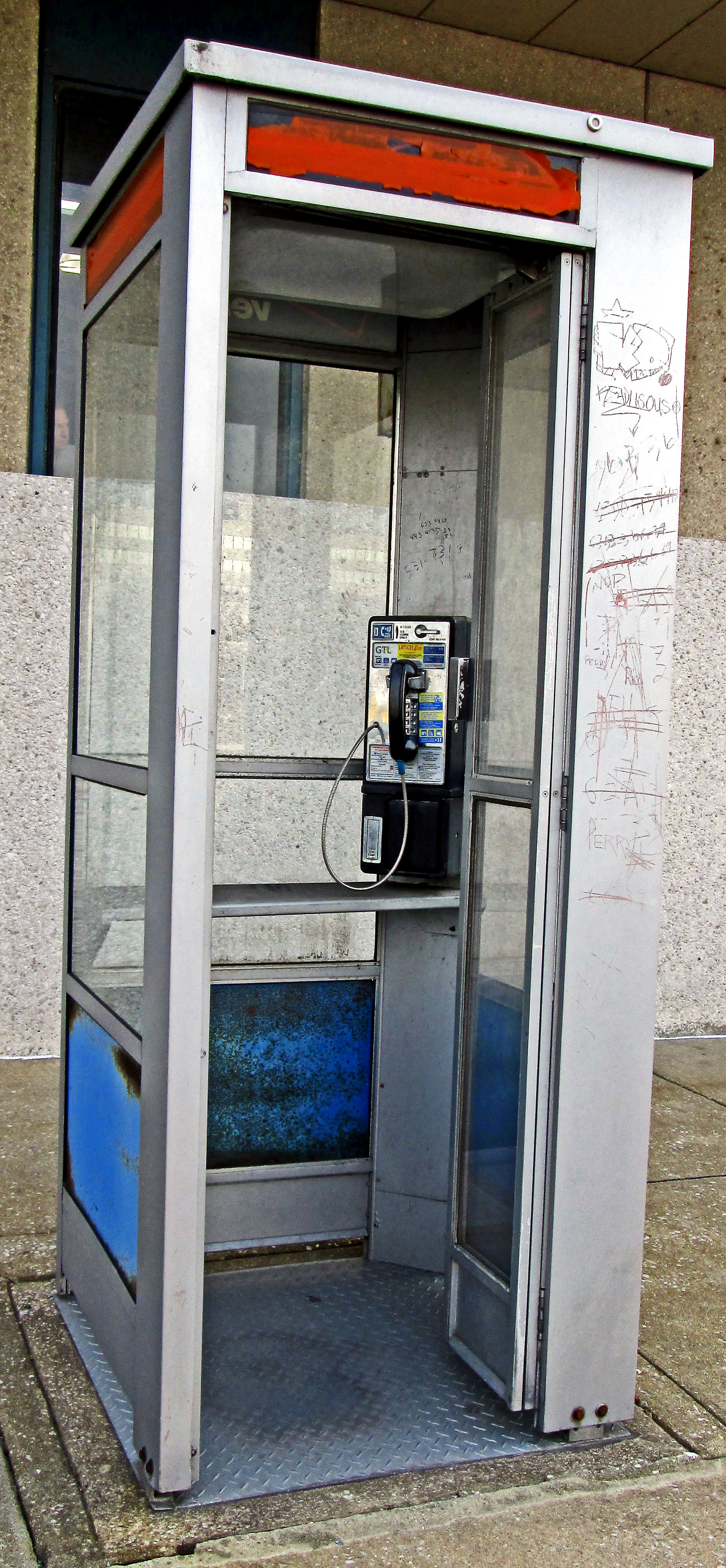 Old Pay Phone Booth With Open Hinge Door
