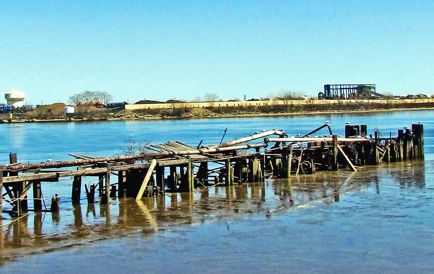 Damaged Pier Reaching Out From The Shoreline