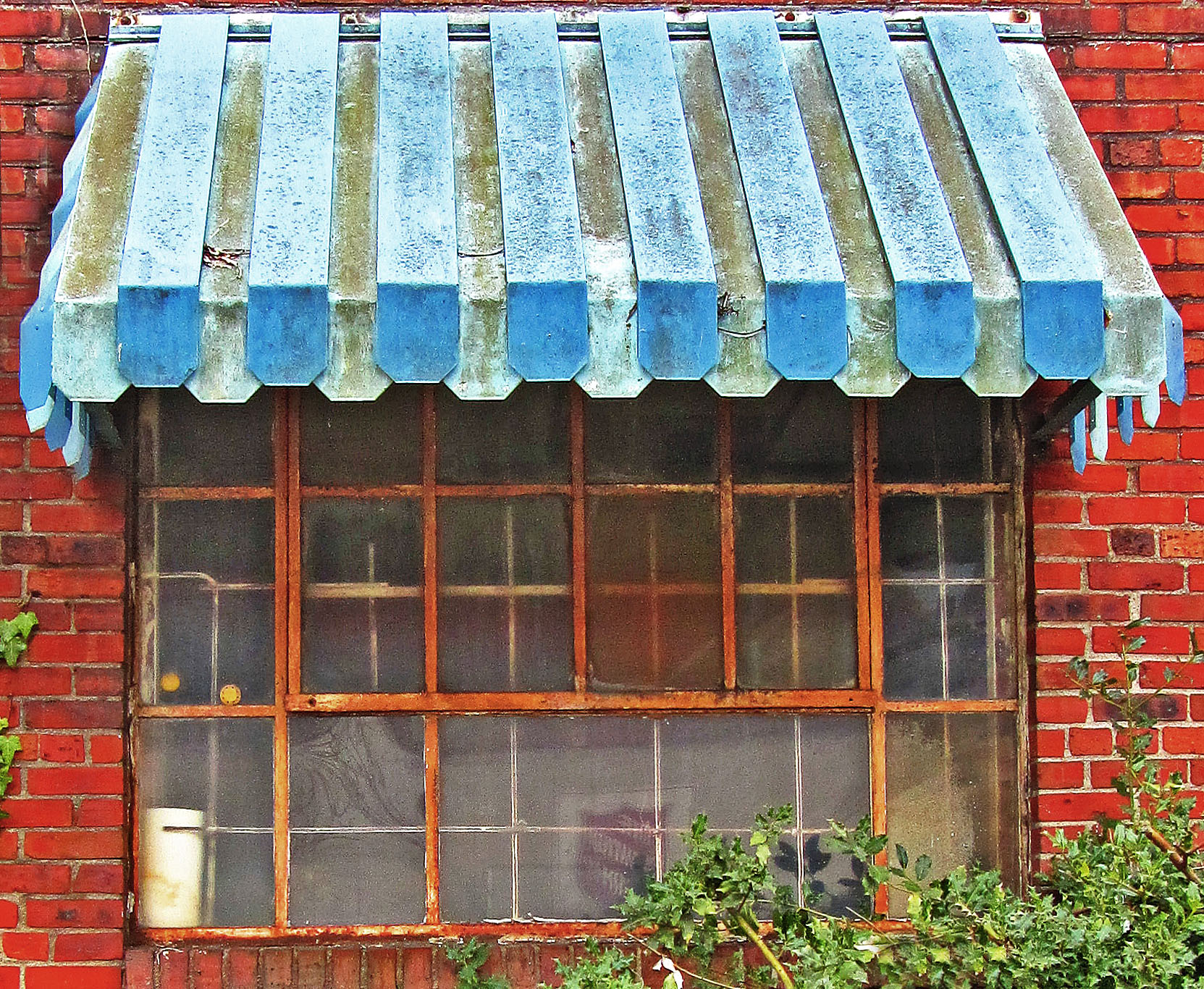 Old Rusted Window & Metal Awning